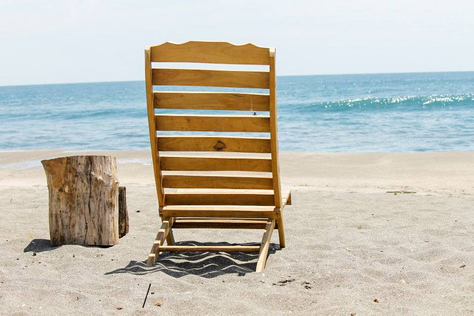 wooden chair and a beautiful beach view